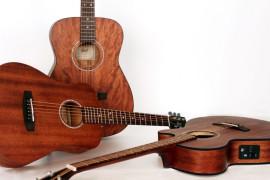 Cort laiž klajā sarkankoka akustisko ģitāru modeļus