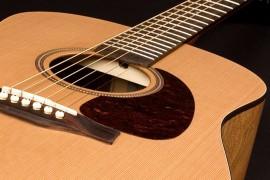 Kā regulēt ģitāras grifu